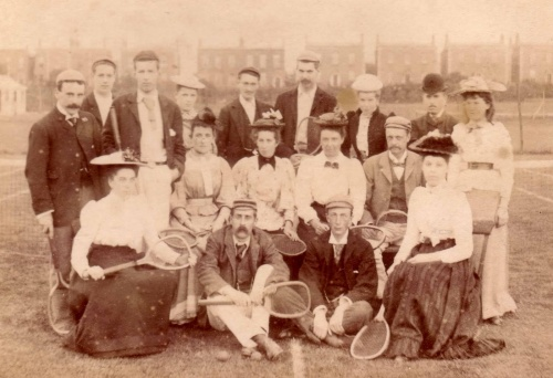 This tennis club photograph, 1890s, shows a version of late-Victorian tennis dress for mixed players.
